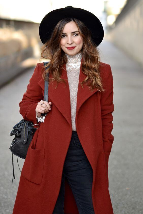 Brick red is the season's most talked about shade, and so a longer-length coat in this sultry color is a must-have style item. Paired with dark blue denims and a lace top, the effect is simply luminous!
