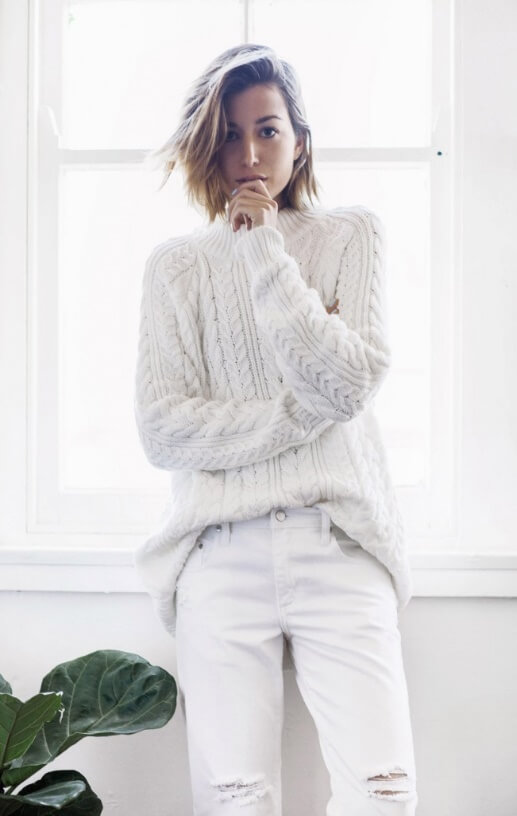 When the cold weather outside seems too gloomy to bear, wrap yourself in the brightest, whitest woolen knits you can find. Like here: ripped boyfriend jeans and a roomy cable-knit sweater.