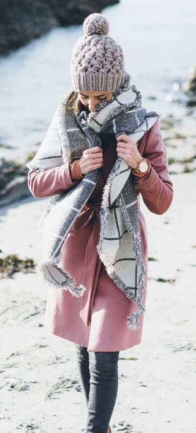 We've all got that one beloved, wear-everywhere coat that has stood by us through thick and thin. Give it a new lease on life by layering an oversized shawl and matching bobble top beanie for the coziest winter finesse.