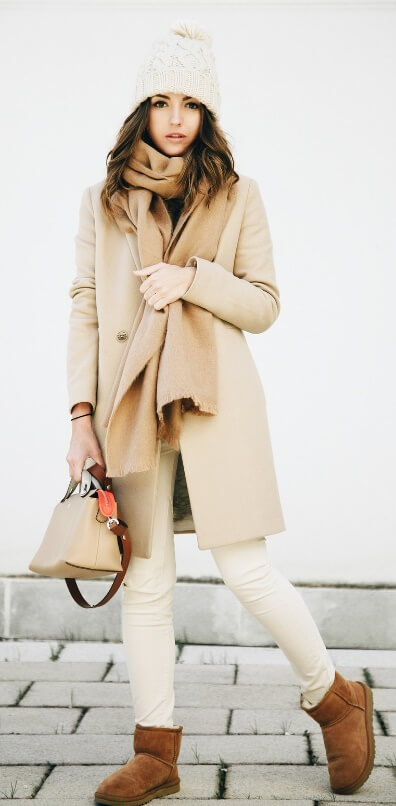You'll struggle to find any shoes more comfortable than Ugg boots. Make an entire outfit out of it – cozy beige-colored items all styled together in the most simple yet chic winter way.