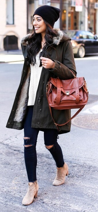 Simply slip on a black beanie and your khaki parka over ripped denim jeans for an uncomplicated cozy winter ensemble.