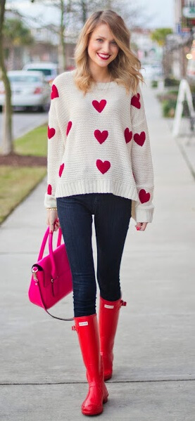 Did someone say Betty Boop? Let your sweet side shine through in a heart-adorned sweater matched with comfortable blue denim jeans and beautifully bright boots.