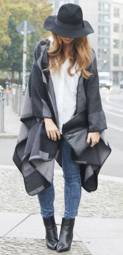 Have a taste for the arts? Let out your creative tendencies in an outfit inspired by abstract cinema noir – acid-washed denim, a black and grey blanket poncho plus a quirky wide-brimmed hat.