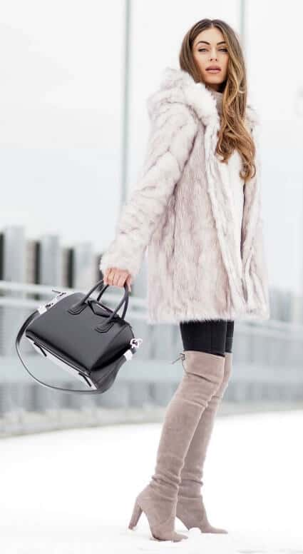 Invest in a hooded fleecy faux fur coat this winter season and create a multitude of different cozy looks. Then pop on your matching over-the-knee boots and rack up some serious style points.