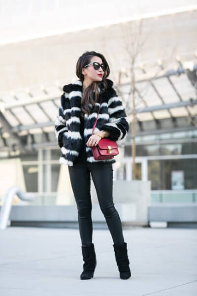 Think old-school French glamour and match slick black basics with a decadent striped faux fur coat. Oh, and don't forget the red lips!
