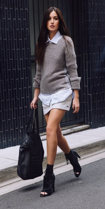 The basis of this look is a light-blue button-down shirt (a denim chambray style would work wonders too). Layer a snug mohair sweater over the shirt and then, for a feminine approach, go for a cheeky miniskirt and sexy peep-toe ankle boots.