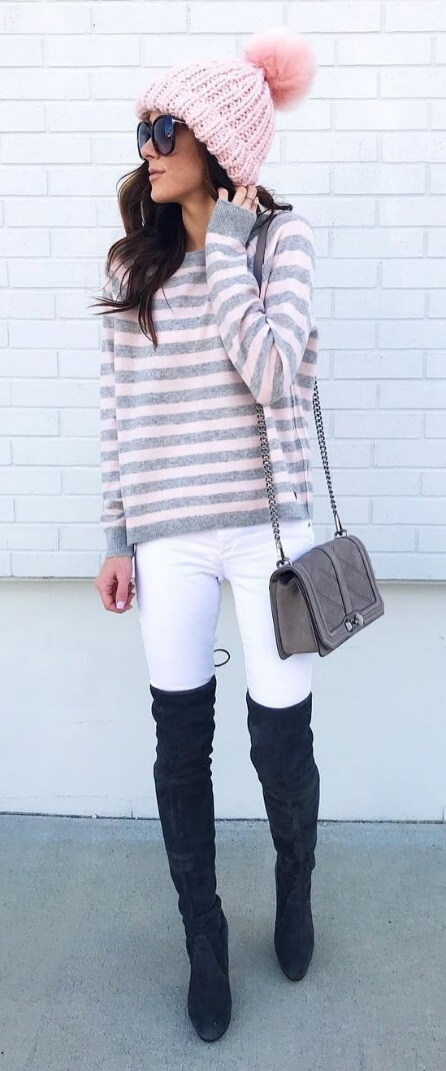 A cute beanie in candy cane pink tops off this sweet street style look. Contrast the pink and white palette with edgy black suede boots and you're good to go.
