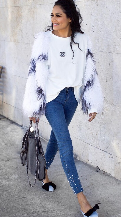 This look is all about the details - cheeky bow ties on powder blue flats, a double-C Chanel T-shirt and plush winter white faux fur.