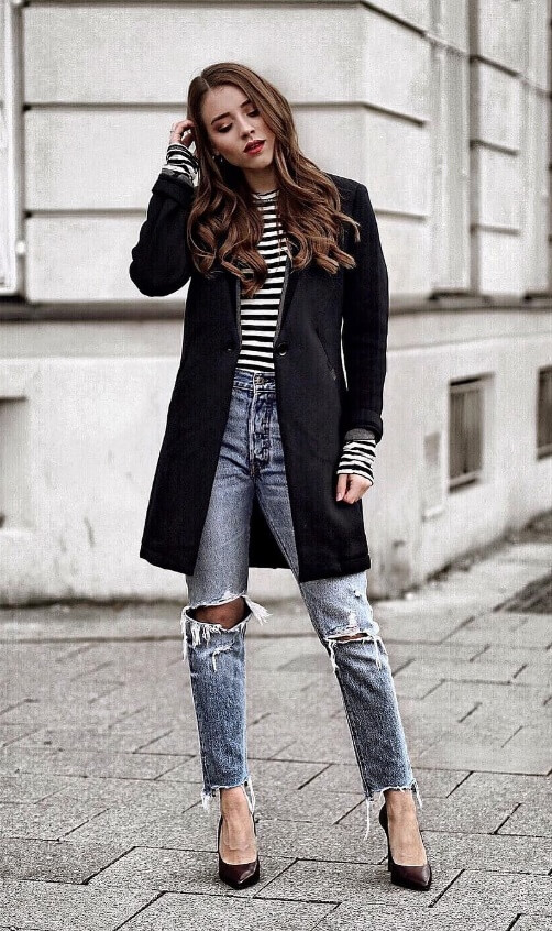 Ripped jeans can be classy too. Boyfriend jeans get a chic upgrade with stiletto heels and a fitted black blazer.