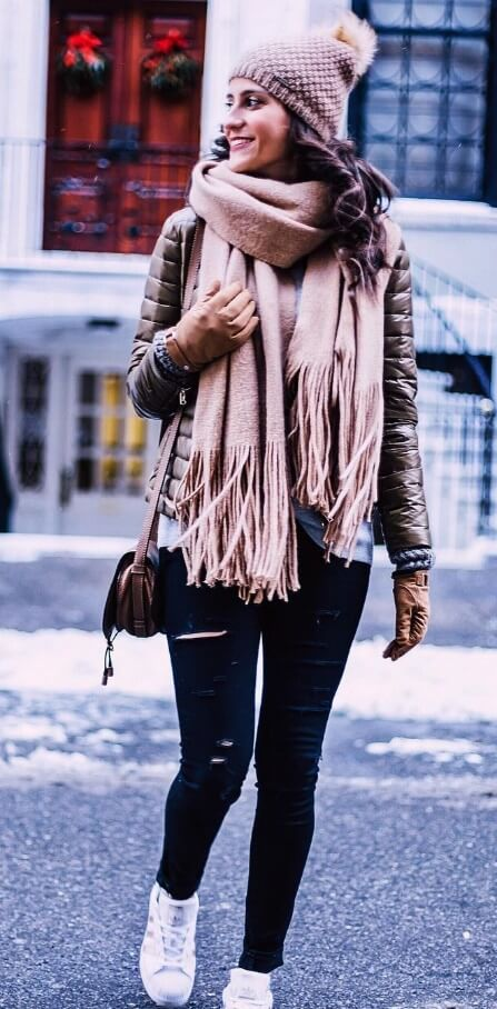 For a look that blurs the lines between feminine and edgy, mix layers of soft baby pink wool with ripped black denim.