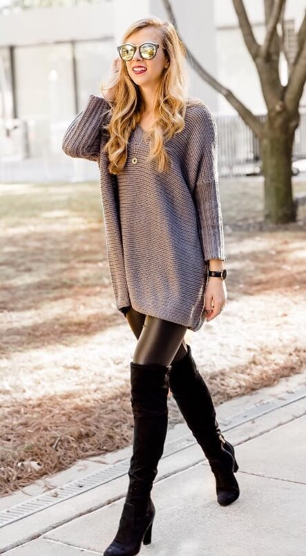 An oversized sweater remains an urban street style staple. Wear it with leather leggings and over-the-knee boots for extra sex appeal.