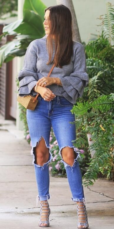 Whoever knew that ripped jeans could be so chic? Get your most distressed pair and style it with a bell-sleeved woolen sweater plus strappy stiletto heels.