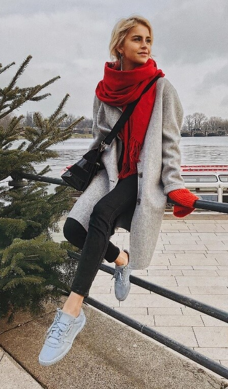 All it takes is a bright red scarf to create a one-of-a-kind outfit. Wrap yourself in the brightest layers you can find, over neutral basic items.