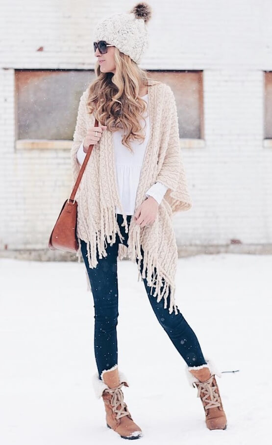 Your inner bohemian deserves a shot at trendy street style too. Wrap up in a fringed cardigan over blue denim and suede boots for snowy boho chic.