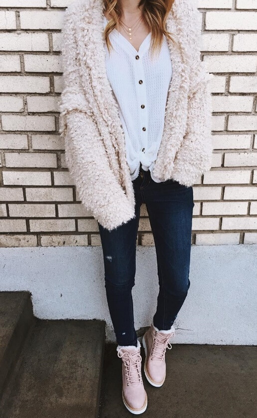 Those pale essentials will come into good use underneath a baby pink faux fur coat. Denim jeans and matching pink Timberland boots wrap up the girly street style ensemble.