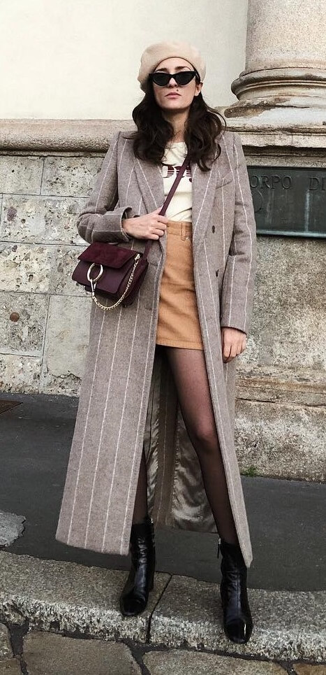 Prefer to keep things serious and businesslike? Normcore is the latest buzzword in fashion circles, starting with pinstriped basics like this long winter coat.