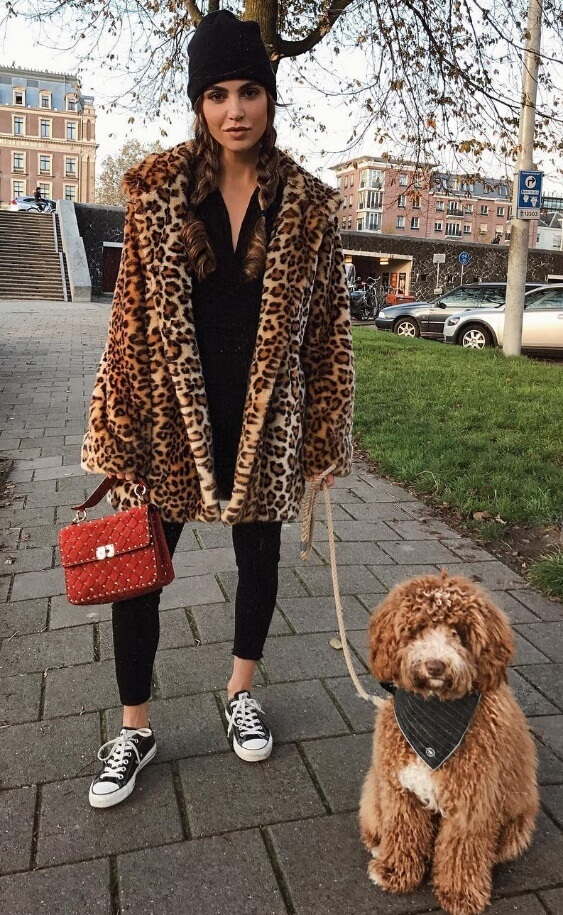 If you haven't got leopard print in your wardrobe yet, consider this your cue. It only takes basic black and sneakers to create a head-turning street style outfit.