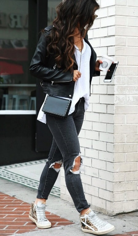 Possibly the easiest of all street style ensembles, we simply adore the combination of ripped skinny jeans, leather jacket and trainers.