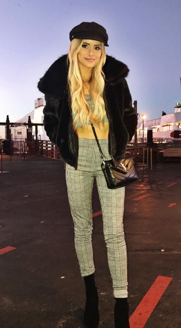 Quirky pinstripe plus black faux fur makes for the unexpectedly cool Instagram style.