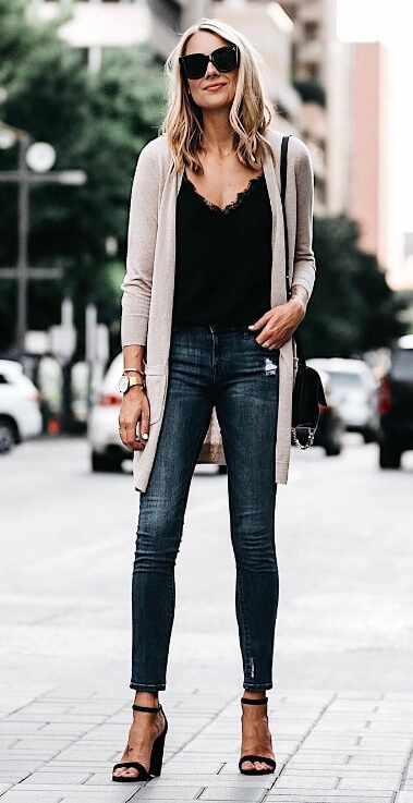 A long cardigan in a soft blush shade is the ideal way to add some texture and warmth to an everyday outfit of jeans and a camisole.