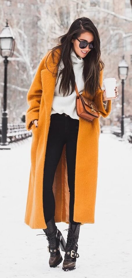 Find a signature item this winter and wear it with pride. It doesn't get any more avant-garde than an ankle-length coat in decadent mustard yellow.