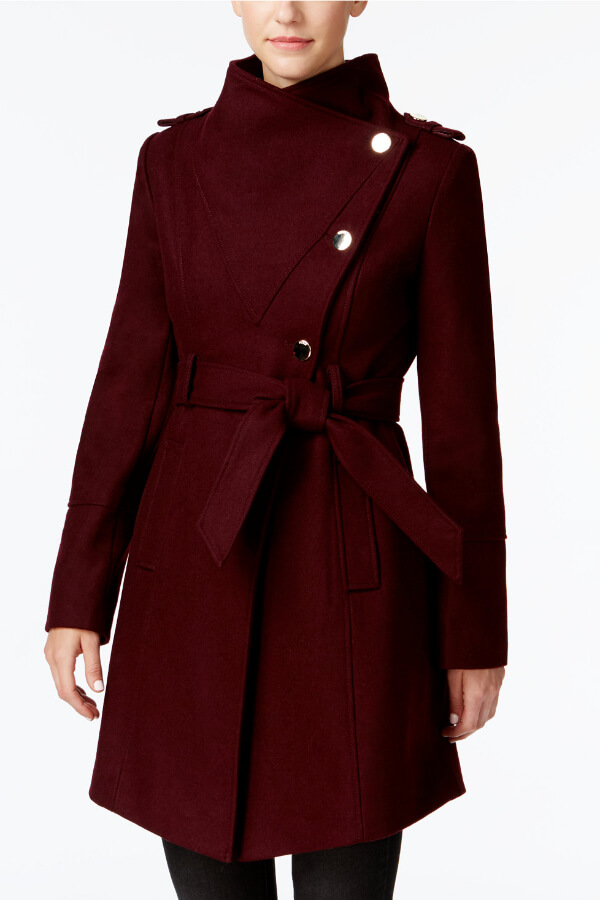 Dress to kill in this flattering asymmetrical coat with a belt. If you like classic silhouettes with a modern twist, this is the winter coat for you