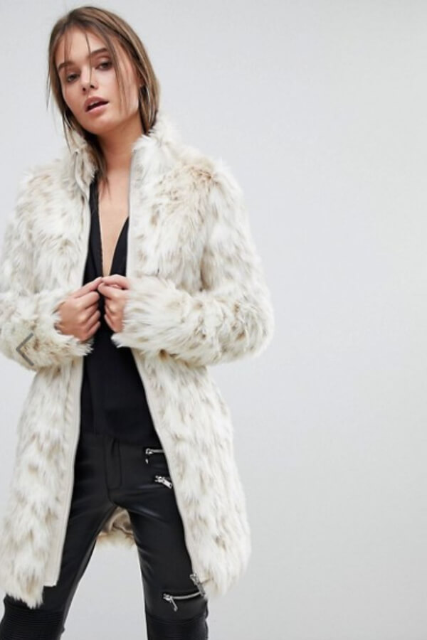 Faux fur is on every runway this season and with good reason. Such White Leopard Faux Fur Coat is cozy, cruelty-free, and will make you look like a million bucks!