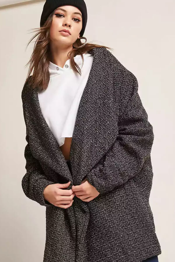 An oversized coat is both incredibly stylish and comfortable as heck! Pair it with fitted leggings, a t-shirt, and knee-high boots to look super chic
