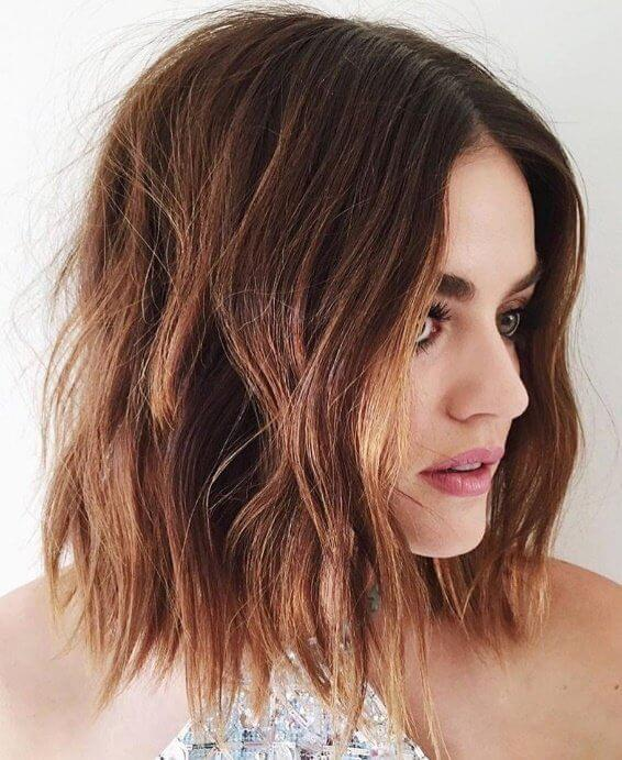 Go for a choppy bob in messy waves to add texture to a brunette mane