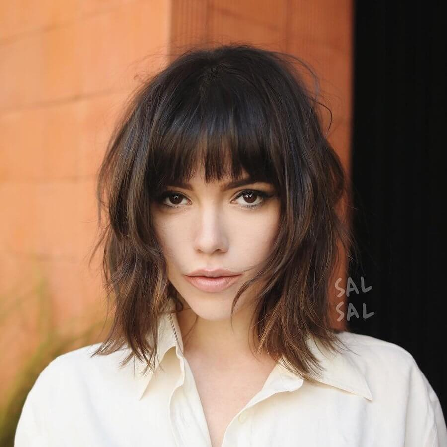 "This haircut has ""French girl hair"" written all over it - wispy, textured and just a little tousled"