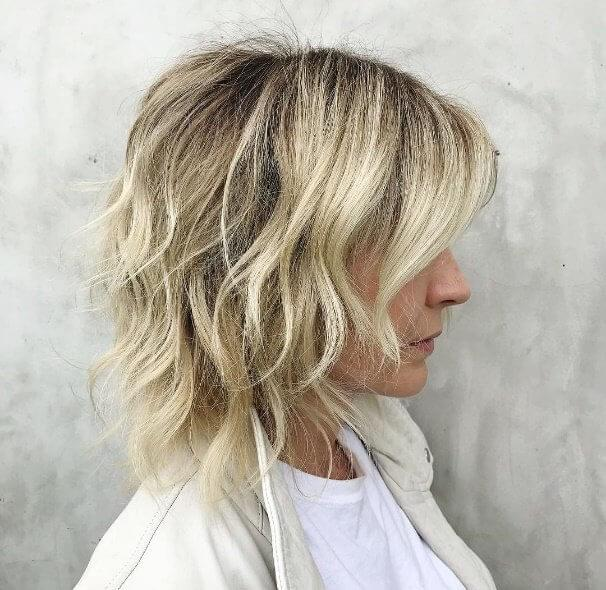 Fine hair trimmed into wispy layers come alive with soft blonde highlights