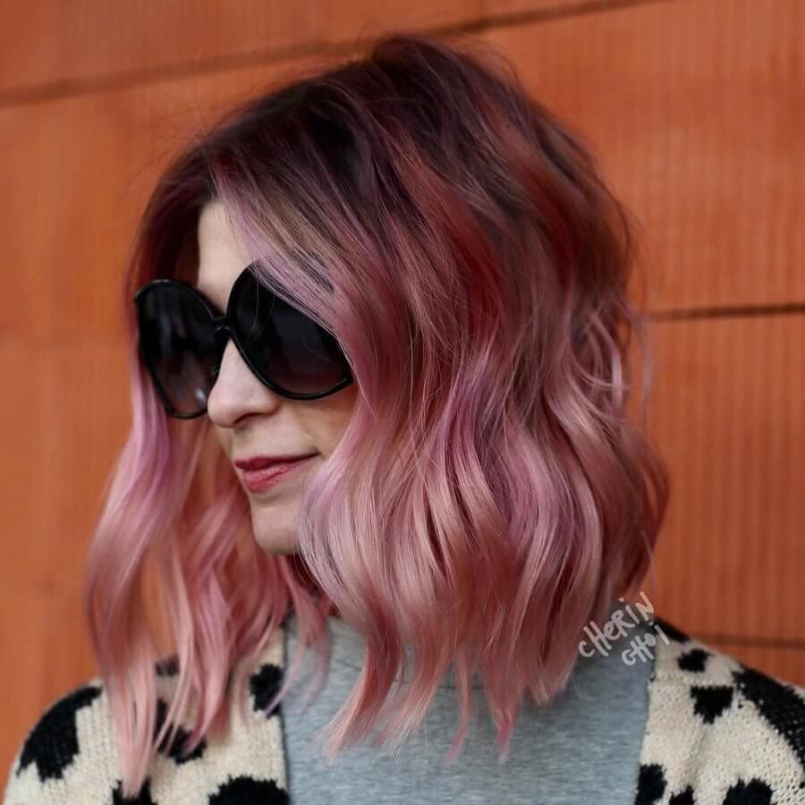 Experiment with different tones of candy cane pink to add bounce to a long bob