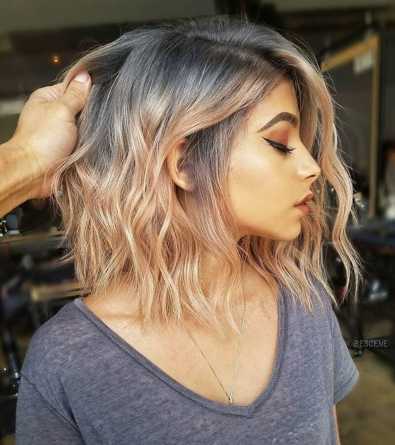 This smoky color starts with charcoal at the roots and blends into gorgeous coral towards the tips of this long straight-cut bob