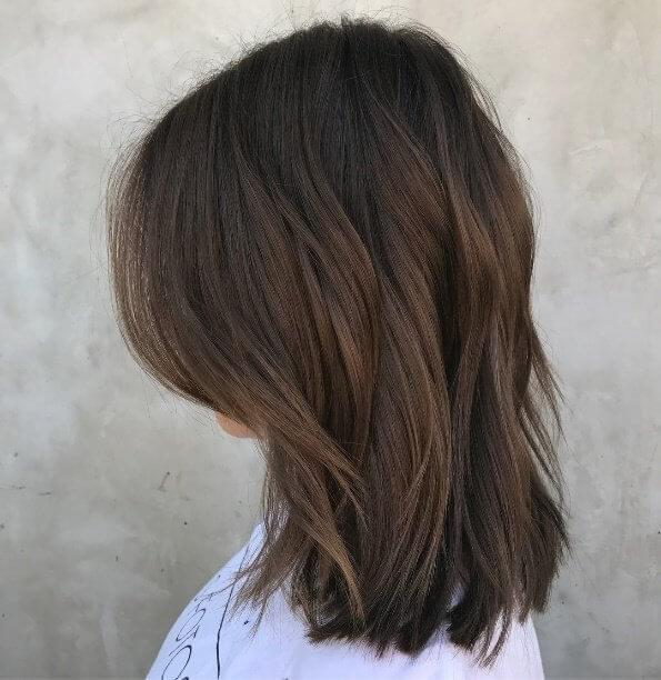Brown hair needn't be boring - ask for blunt cut edges to achieve this look of full textured hair