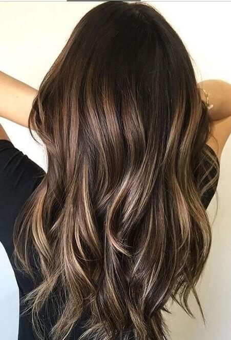 The balayage technique is a favorite for a reason - it creates a luminous glow to long, layered waves