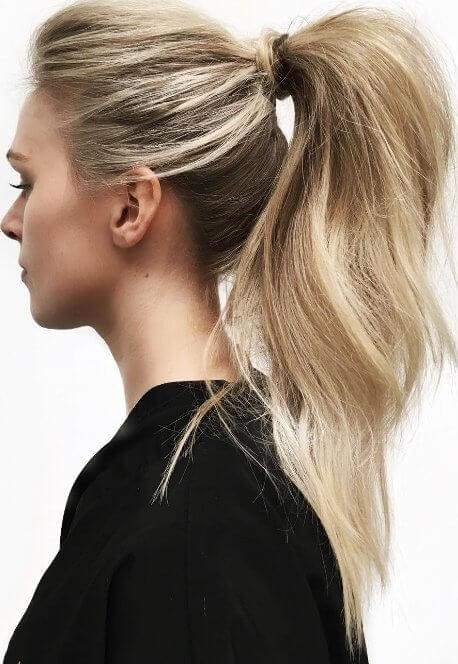 When time is an issue, scrape your long hair into a high ponytail, tease the lengths and voilà!
