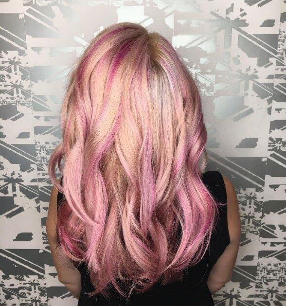Call it the ripple effect - here streaks of pink raspberry dye bring a splash of fun to long blonde hair