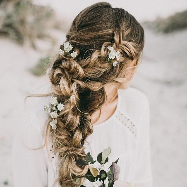 Infuse your long hair with flowers this spring with loose plaits woven throughout the lengths