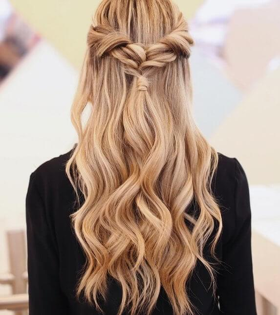 Long hair gets a mermaid makeover with these beach waves mixed with sweet girly braids