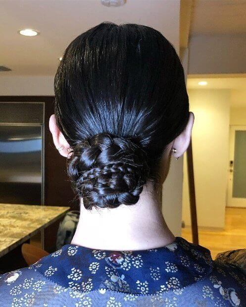 Don't let wet hair ruin your look - simply braid your hair and wrap the plaits into a sleek low chignon