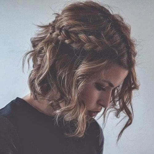 Short hair can get in on the braid trend too - plait two think braids along the front and finish off with soft, flowing waves