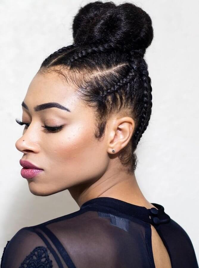 The 90s are back! This hairstyle blends edgy braids with a girly top bun
