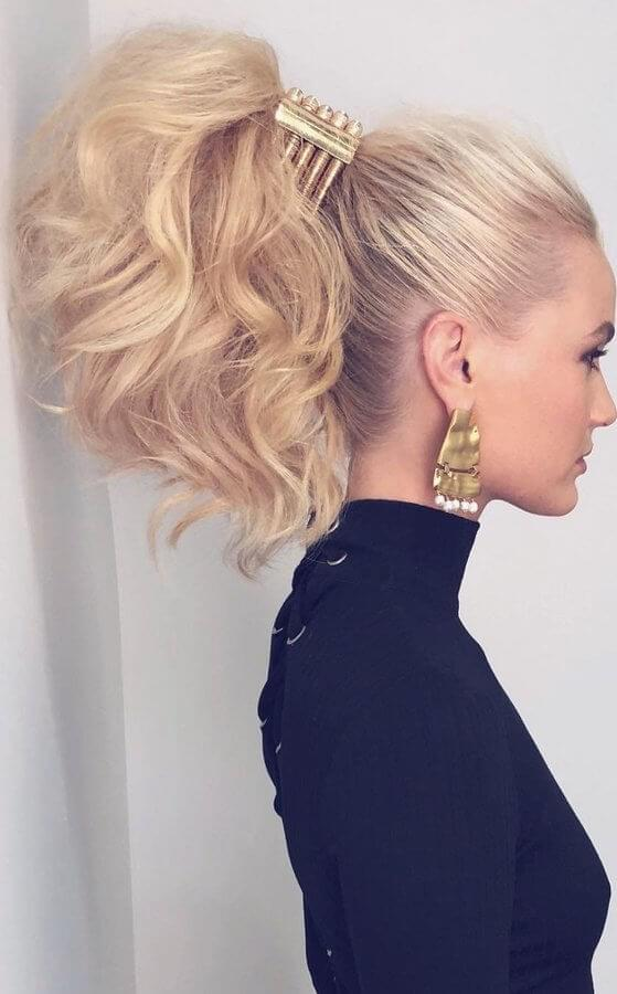 Don't miss out on the big ponytail trend this spring - all it takes is some clever teasing and a huge claw clip accessory