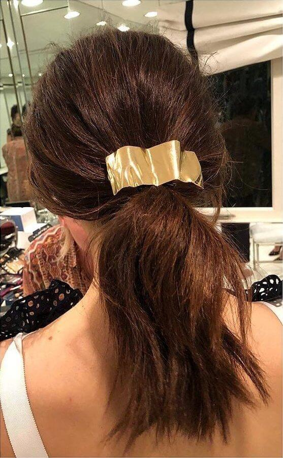 Wave goodbye to bad hair days with a statement hair accessory - scrape your tousled hair back and voilà!