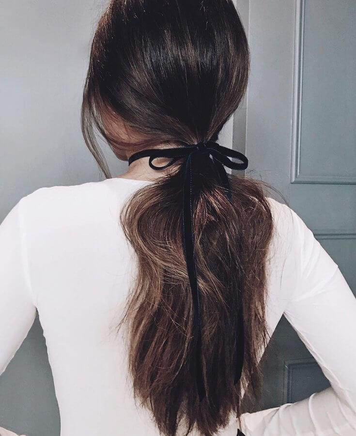 Here's an easy styling option for fancy spring nights - simply tie a velvet ribbon around your low ponytail for a sleek evening look