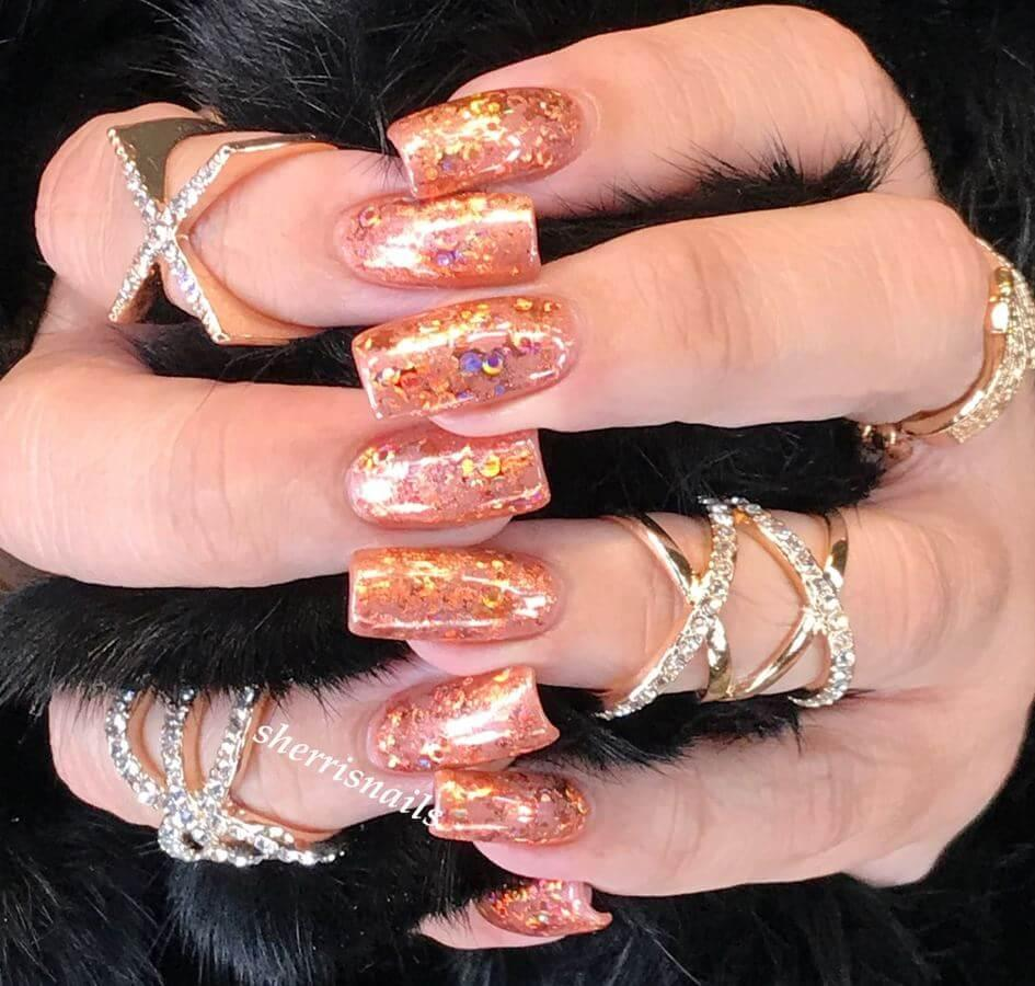 Copper holographic nails with lots of rings will make you stand out from the crowd!