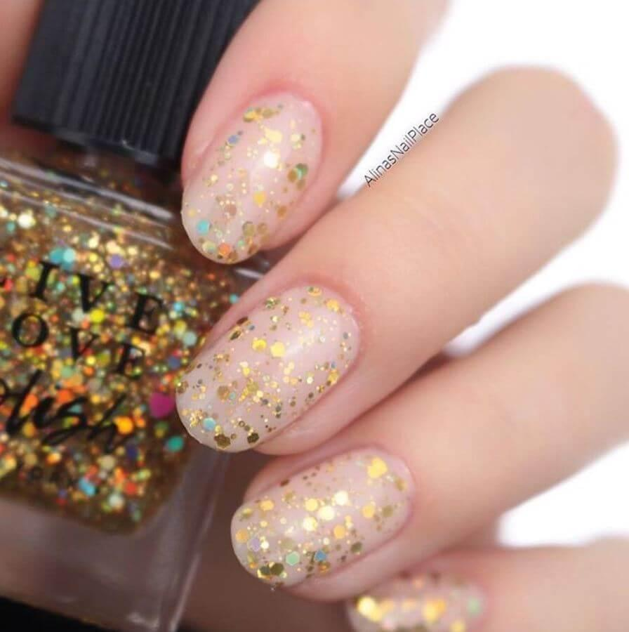 Nude nails with gold specks look amazing!