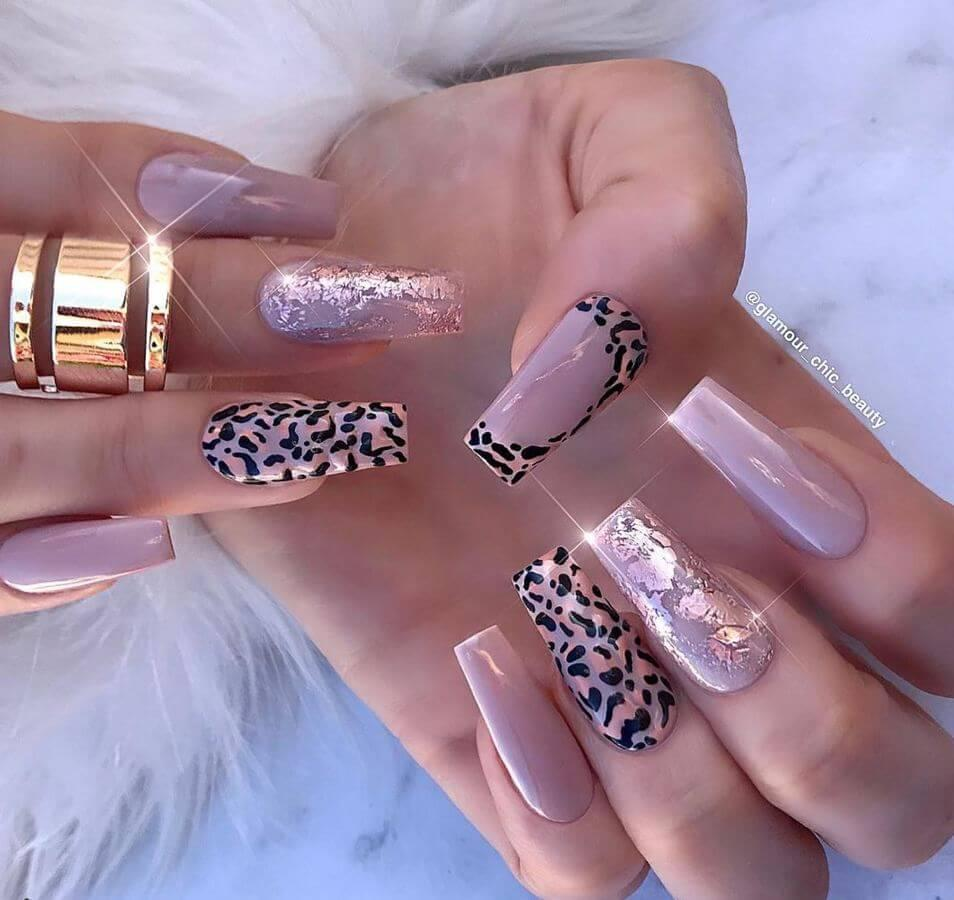 Animal prints combined with a subtle color are nail art perfection!