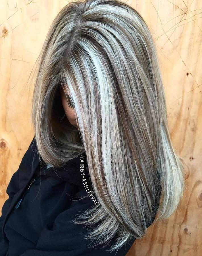 Try ash blonde streaks for that bold 90s look