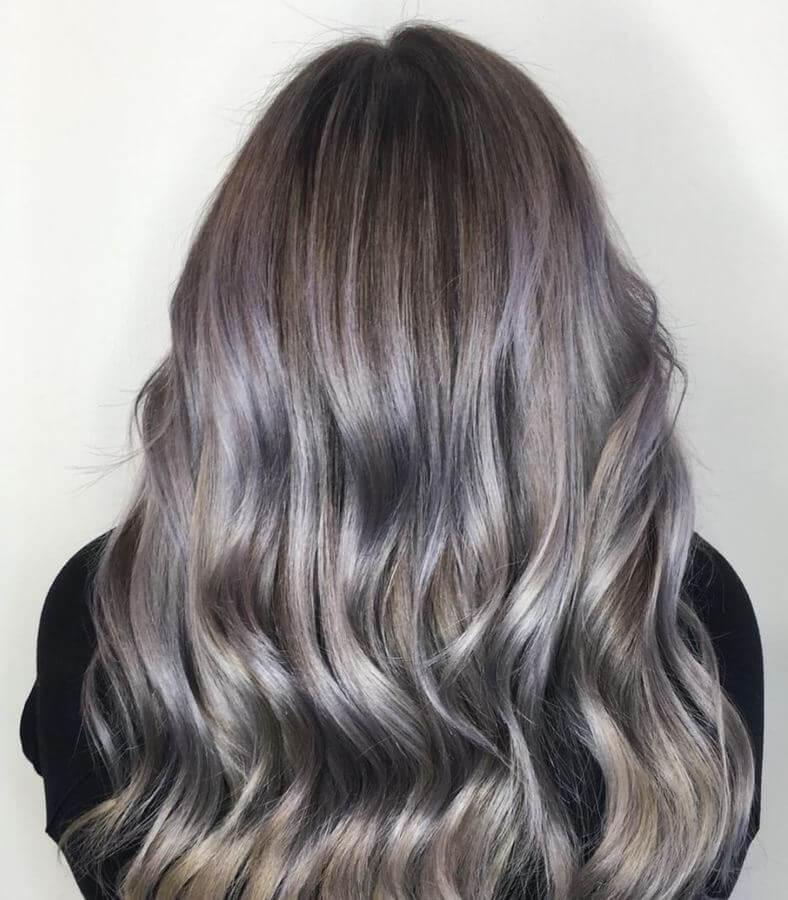 If you're looking for something fun, try this ash blonde and lilac combination. It is the perfect balance between safe and dramatic.